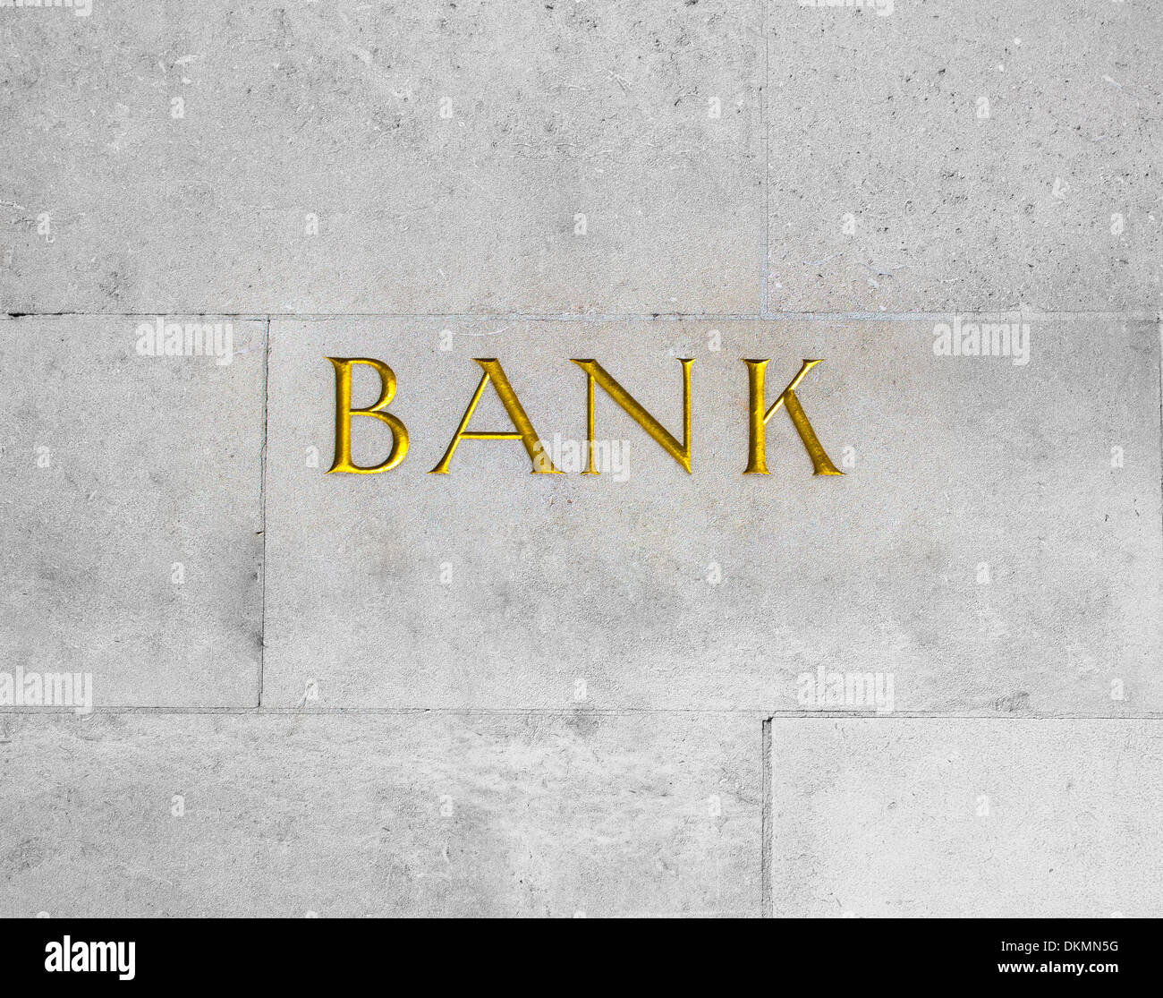 A gold sign for a bank - Stock Image