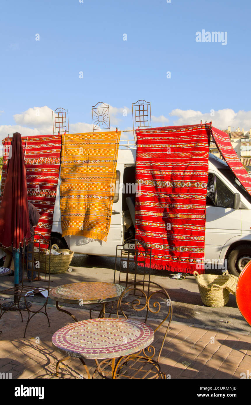 Moroccan style rugs and furniture for sale on second hand market in Fuengirola ,Spain. - Stock Image