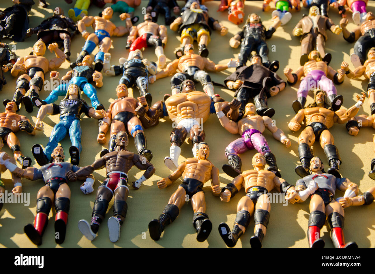 Collection of wrestling figures for sale on a second hand market in Fuengirola, Spain. - Stock Image