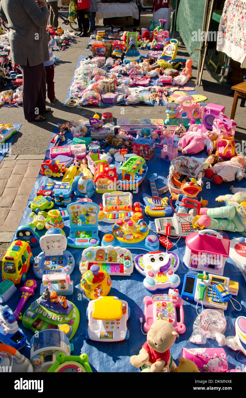 Second hand children's toys for sale on the market. Fuengirola, Spain. - Stock Image