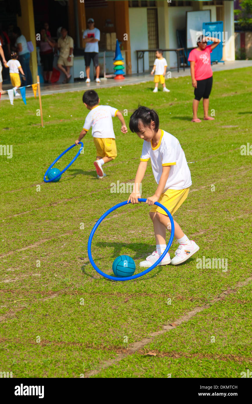 kids are playing the drag the ball race at a kindergarten sport day stock photo 63767777 alamy. Black Bedroom Furniture Sets. Home Design Ideas