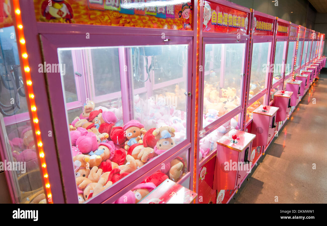 Pokemon claw crane game in undergrounds of Bund Sightseeing Tunnel in Shanghai, China - Stock Image