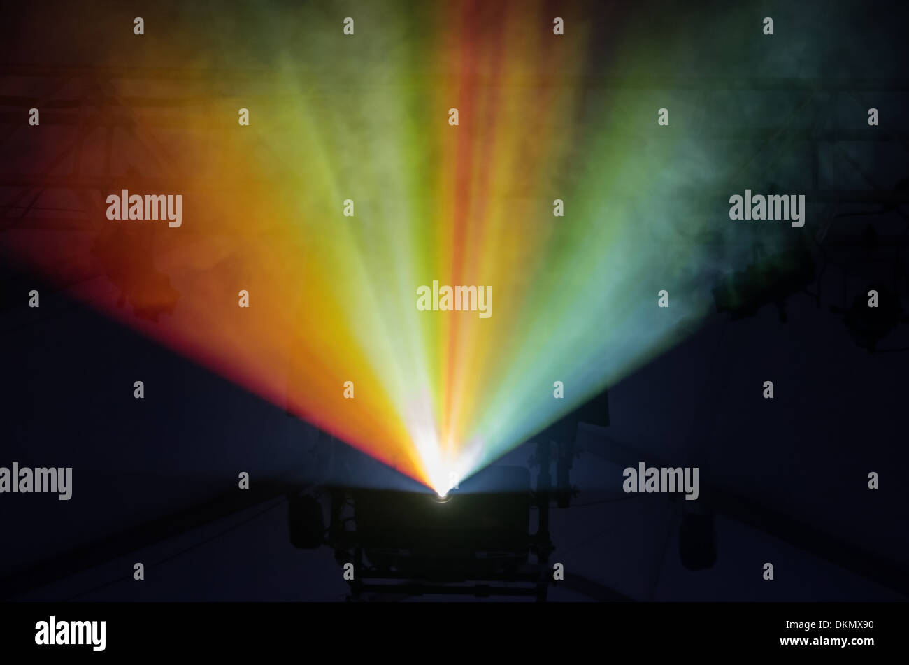 colored stage lights illuminate fog in a rainbow - Stock Image