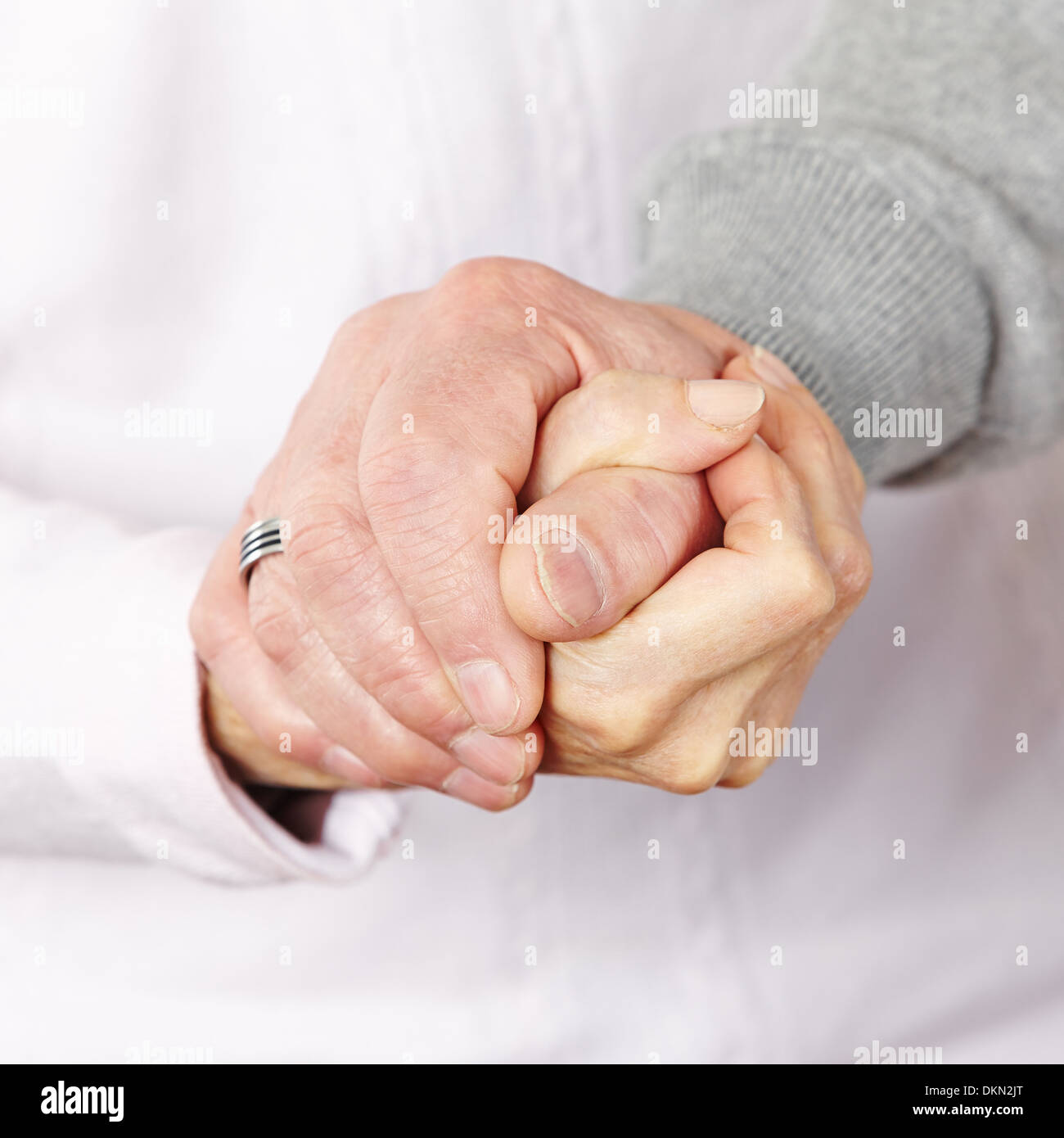 Happy senior citizen couple holding their hands together Stock Photo