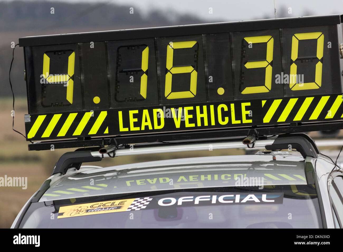 Large elapsed digital display race timer on lead vehicle, Cicle Classic Race 2013 cycle race. - Stock Image