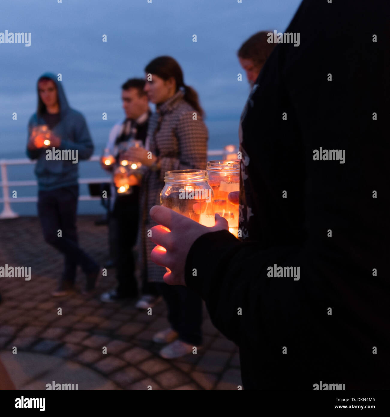 AberPride holding a candle-lit vigil at dusk on Aberystwyth promenade  in advance of the Transgender Day of Remembrance - Stock Image