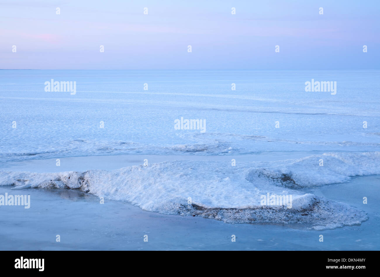 An evolving landscape of thawing and shifting ice graces Lake Simcoe in the early spring warmth. Georgina, Ontario, Canada. - Stock Image