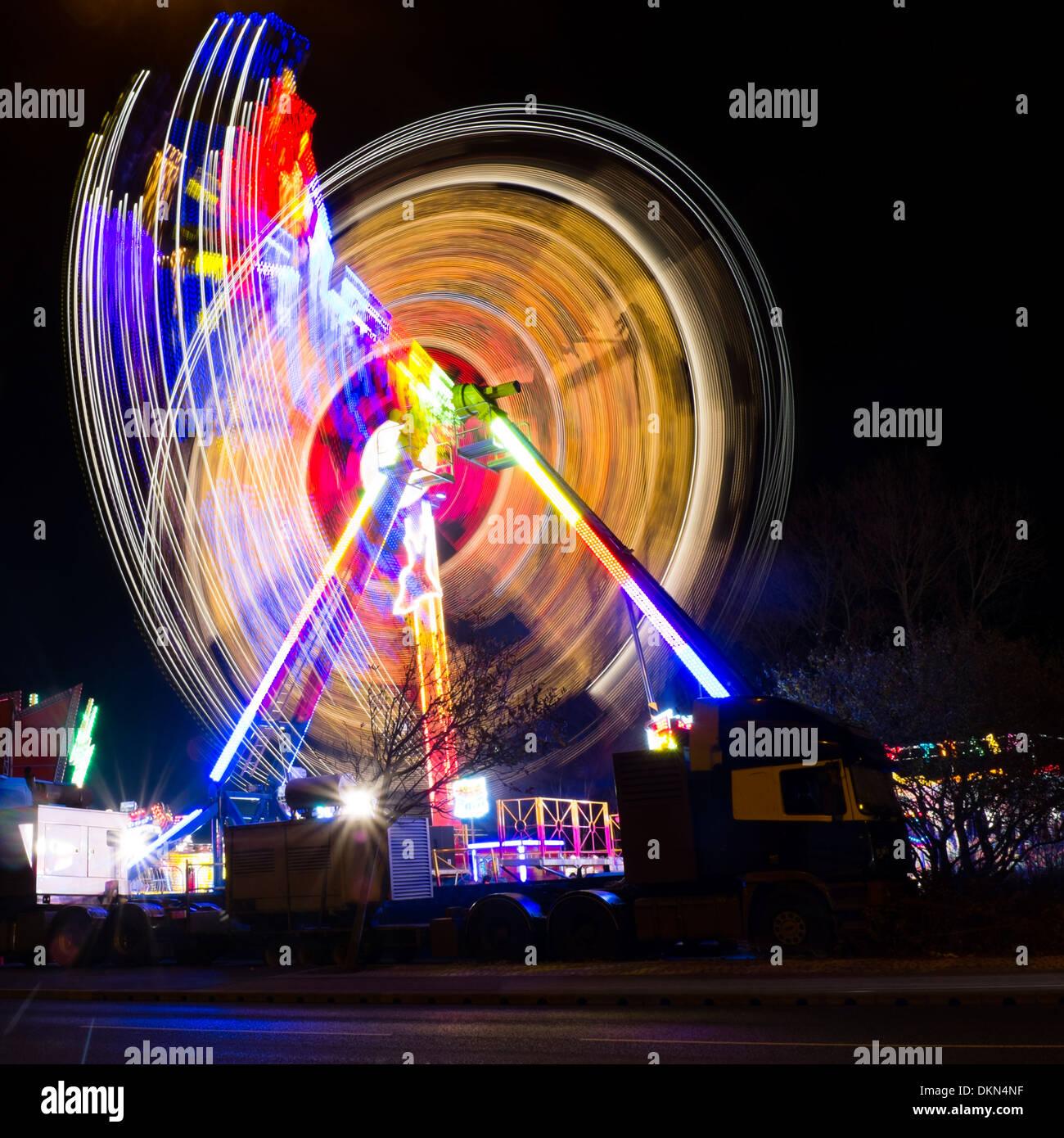 Light trails, long exposure photograph Aberystwyth Fair, Wales UK - Stock Image