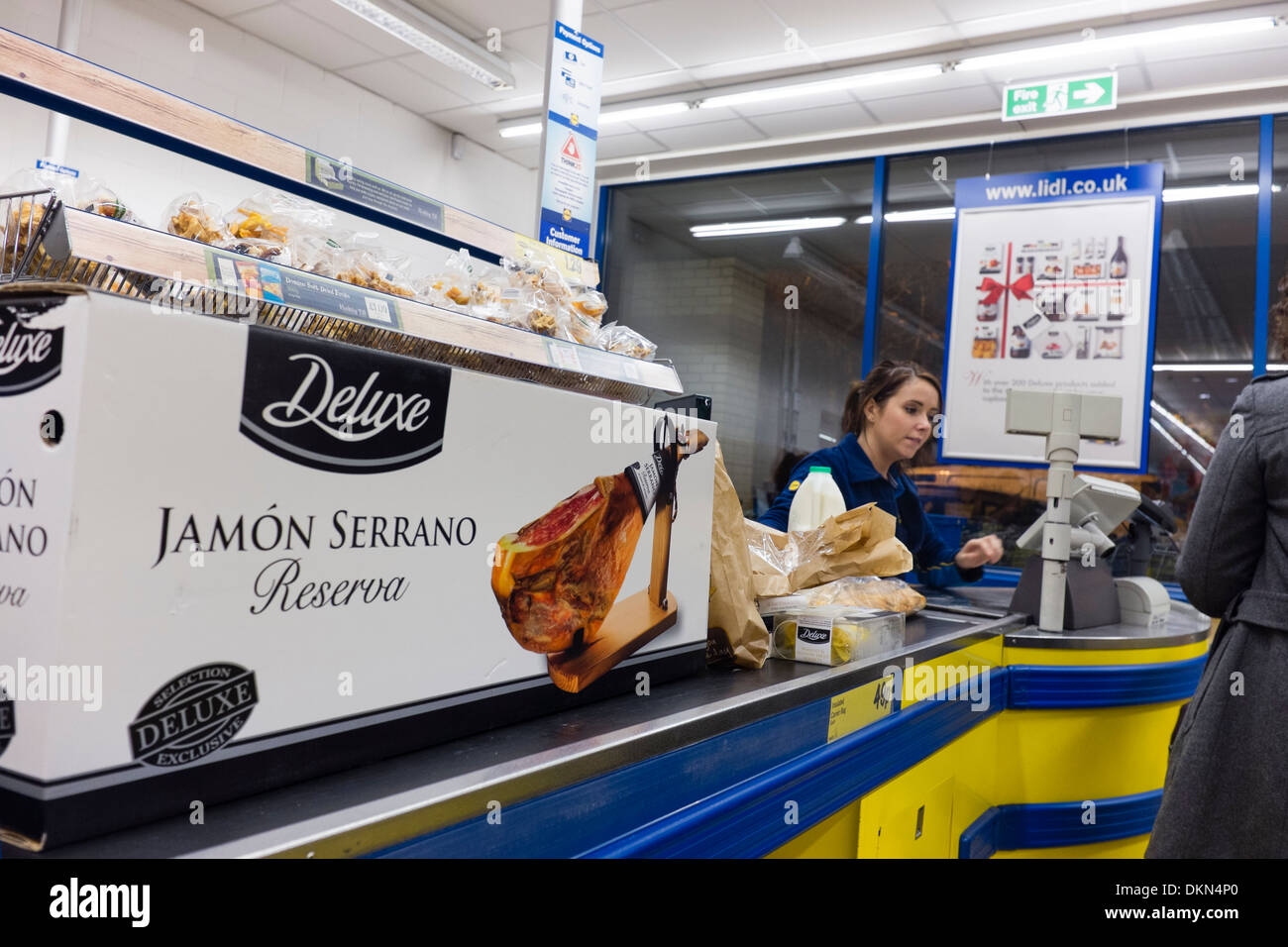 A whole Serrano ham, one of Lidl discount supermarket 'Deluxe' range of foods, at the checkout, about to be scanned, UK - Stock Image