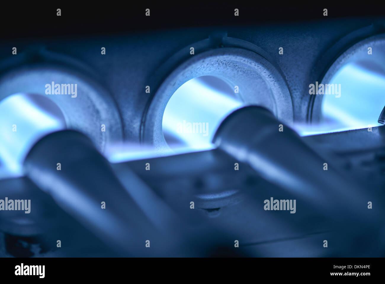 Power Concept - Closeup Shot Of Home Furnace Burner Ignited - Stock Image