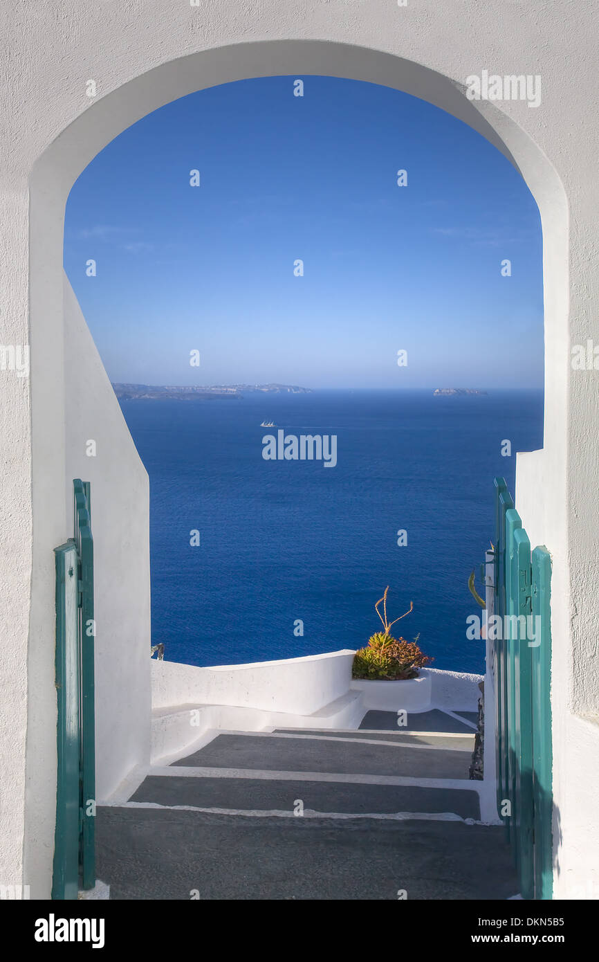 A doorway leads to the caldera of Santorini, a wonderful escape in the Greek islands - Stock Image