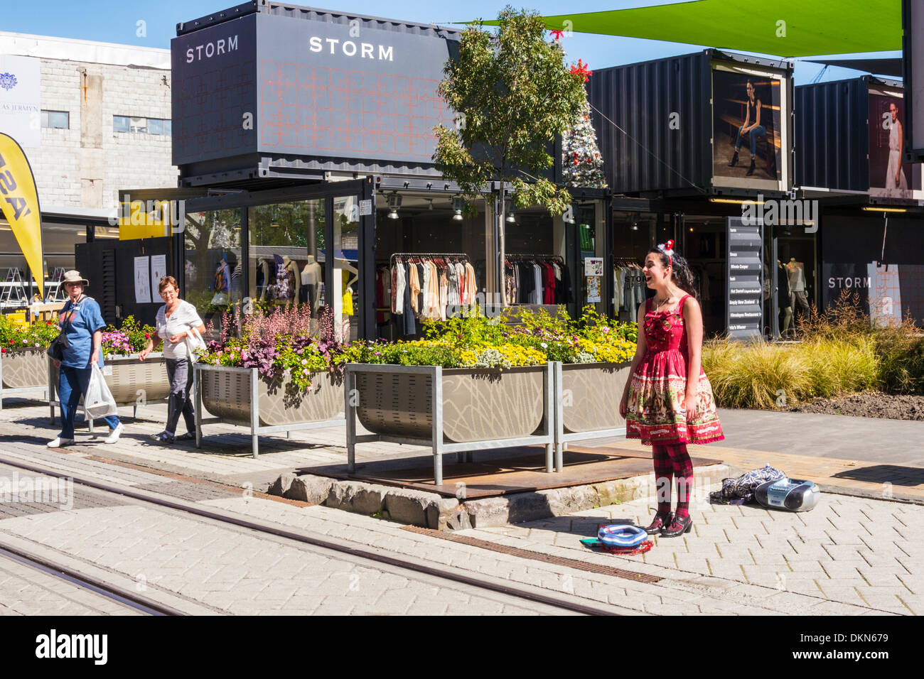 Busker at the Christchurch Container Mall, Christchurch, New Zealand. The Container, or Re:Start, Mall was built from shipping.. - Stock Image