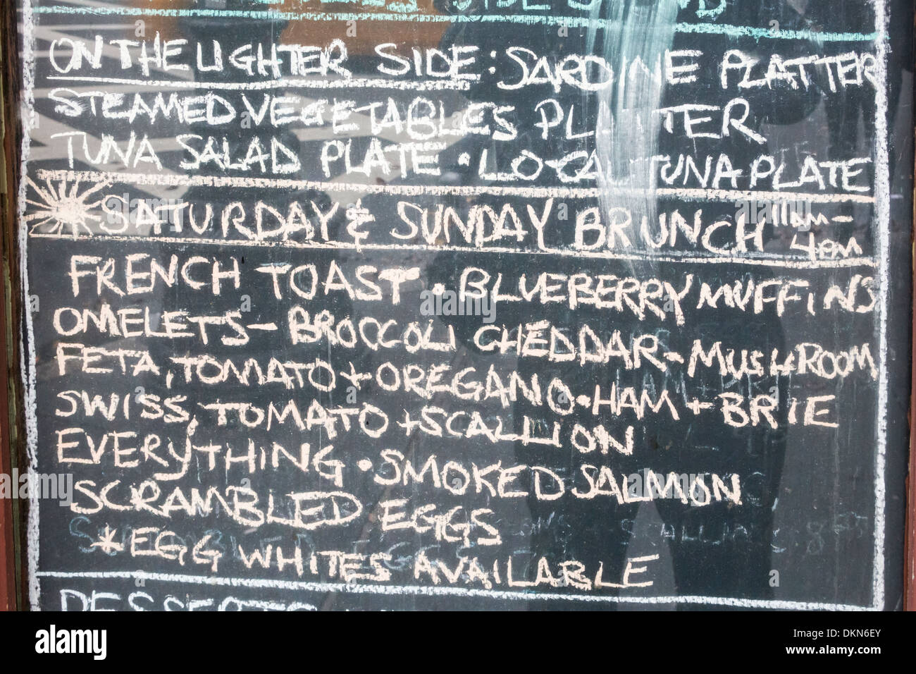 chalkboard menu outside a bar restaurant in soho, new york stock