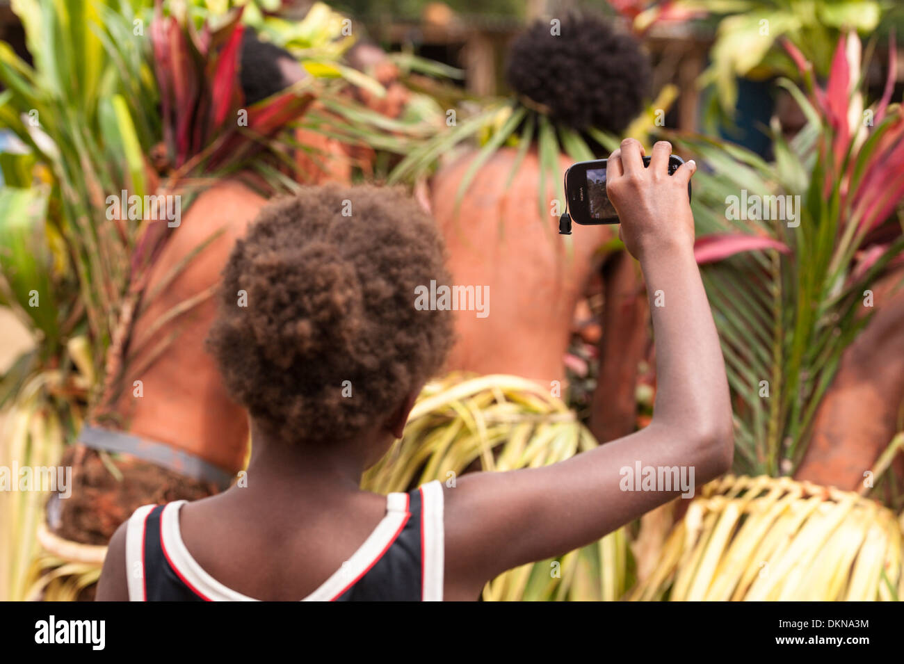 Ni-Van boy with Nokia mobile phone filming dancers performing in Fest' Sawagoro a celebration of traditional culture in Vanuatu - Stock Image