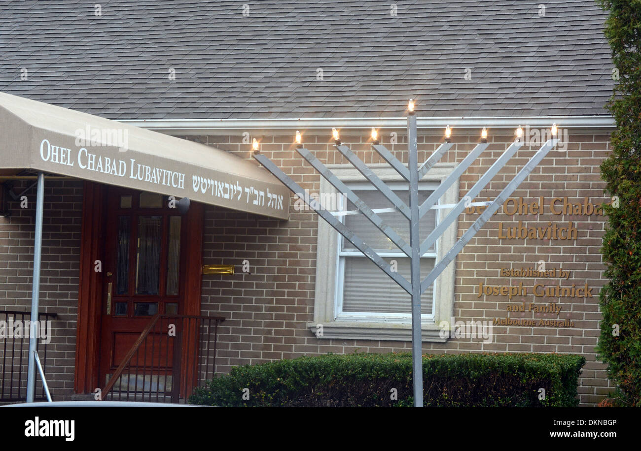 A Menorah on the final day of Hannukah outside the Ohel in Cambria Heights, Queens where the Lubavitcher Rebbe is buried; - Stock Image