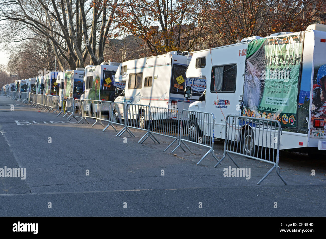 A row of Lubavitch Mitzvah Tanks line up in Crown Heights, Brooklyn, New York for a Hanukkah day Parade. - Stock Image