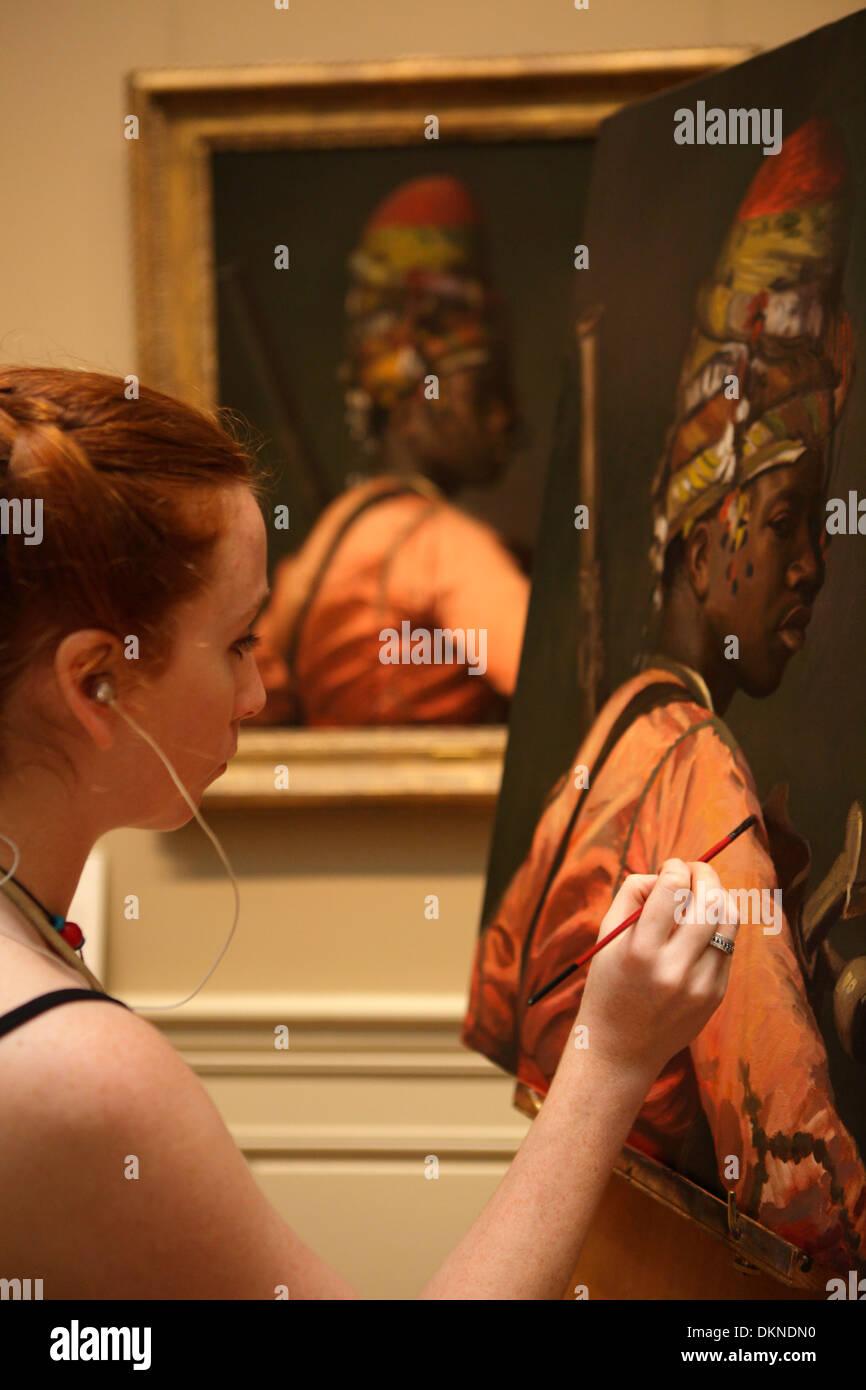 Artist reproducing a painting at Metropolitan Museum, New York City, USA - Stock Image