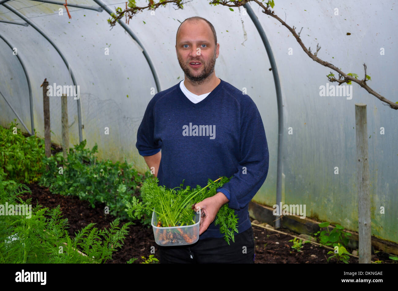 Simon Rogan, chef and owner of Michelin starred restaurant L'enclume on his farm in Cumbria - Stock Image