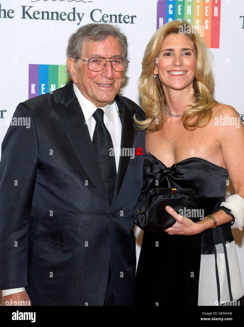 Washington DC, USA. 7th Dec, 2013. Tony Bennett and his wife, Susan Crow, arrive for the formal Artist's Dinner honoring the recipients of the 2013 Kennedy Center Honors hosted by United States Secretary of State John F. Kerry at the U.S. Department of State in Washington DC, USA, 7 December 2013. Photo: Ron Sachs / CNP/dpa/Alamy Live News - Stock Image