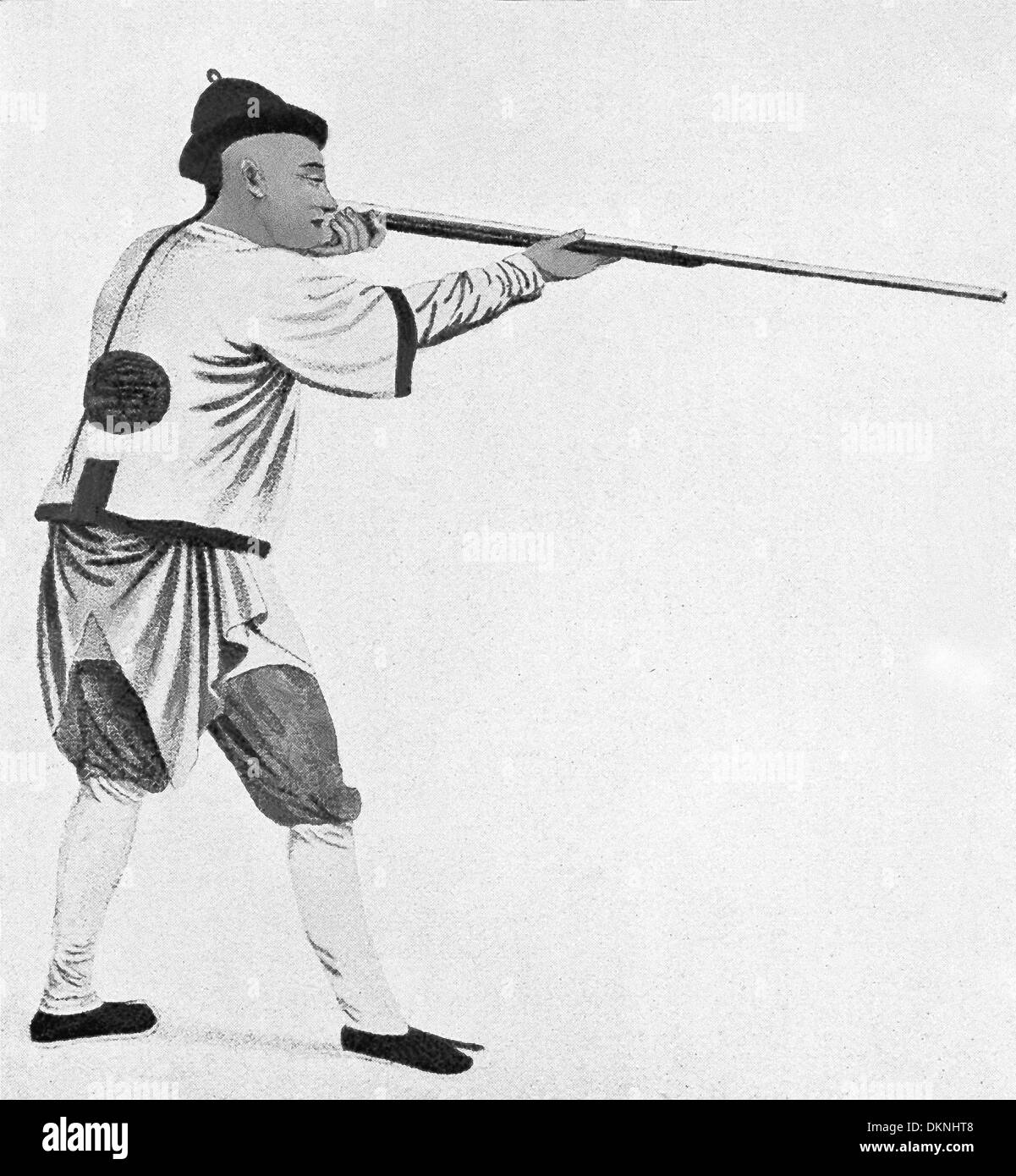 This illustration of a Chinese soldier, aiming his gun, dates to 1900. The time period in China is the Boxer Rebellion. - Stock Image