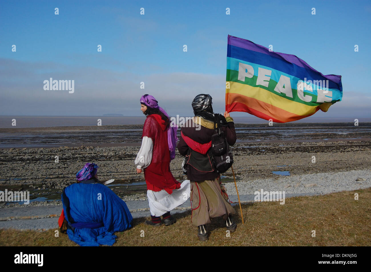 Protesters looking out to sea from the beach situated near the proposed site for Hinkley Point C nuclear power station - Stock Image