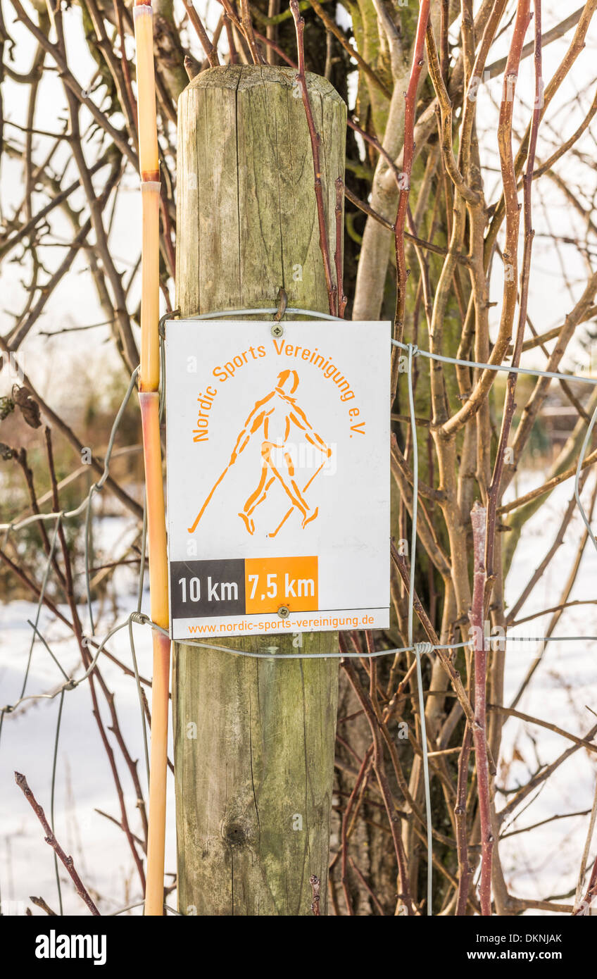 sign indicating a walkin track by the german nordic sports association, stuttgart, baden-wuerttemberg, germany - Stock Image