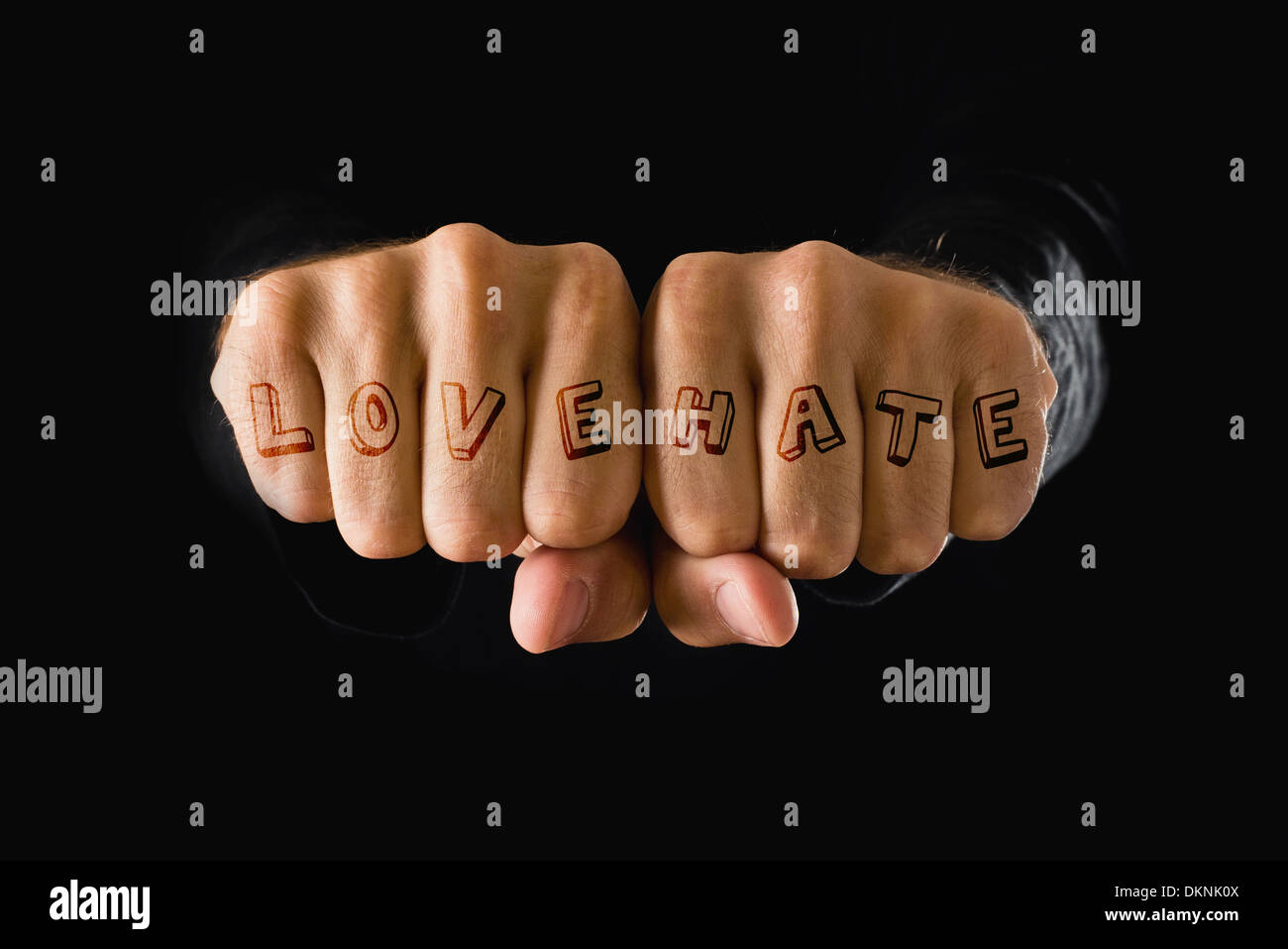 Love And Hate Tattoo Hands With Clenched Fists On Dark Background