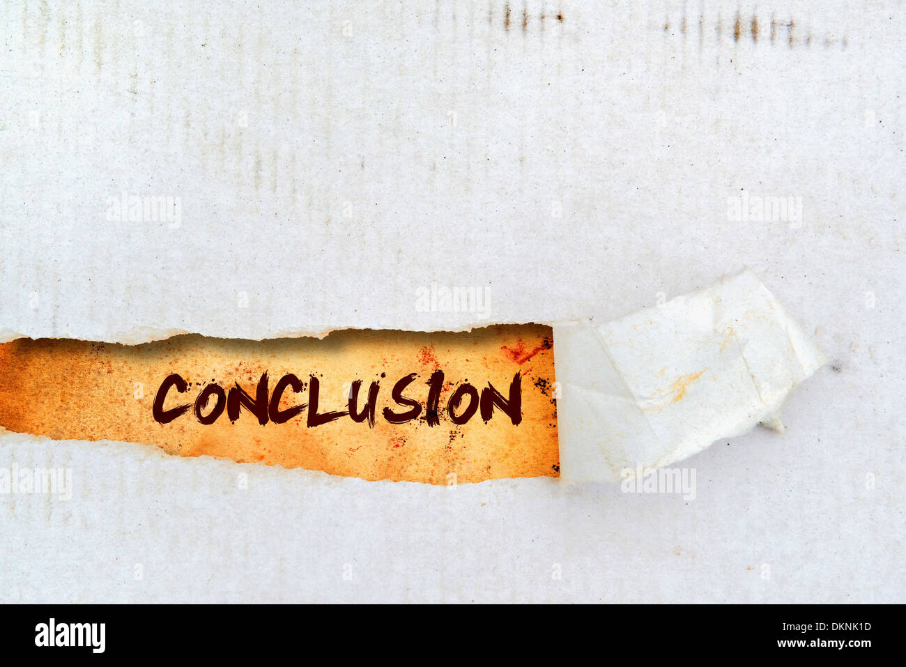 Conclusion title on old grunge torn paper - Stock Image