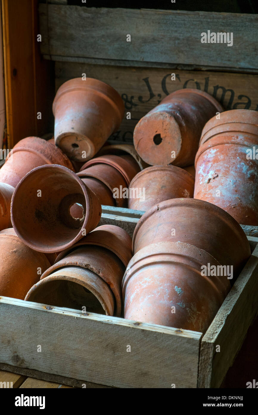 Terracotta pots on the potting bench - Stock Image