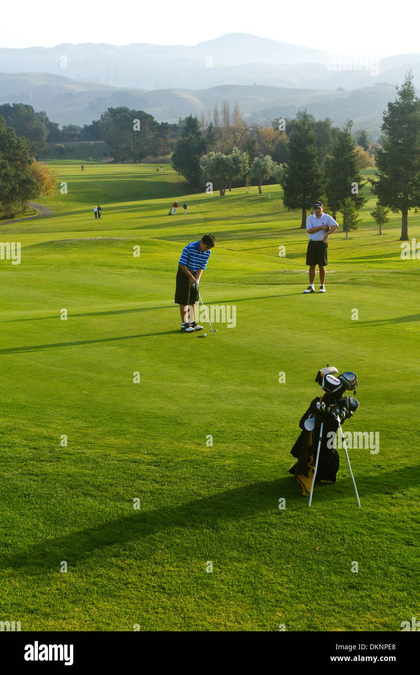 Teenagers  Golf Course - Stock Image