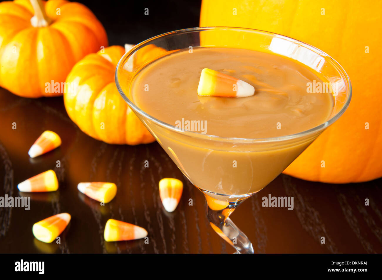 Butterscotch pudding with candy corns and pumpkins - Stock Image