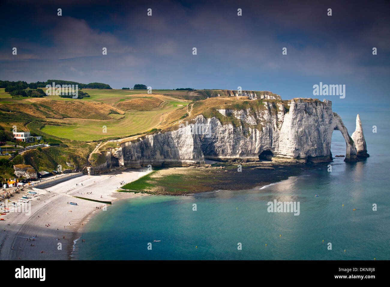Cliffs, natural arch and stone beach. Etretat, Le Havre, Seine-Maritime, Normandy, France, Europe - Stock Image