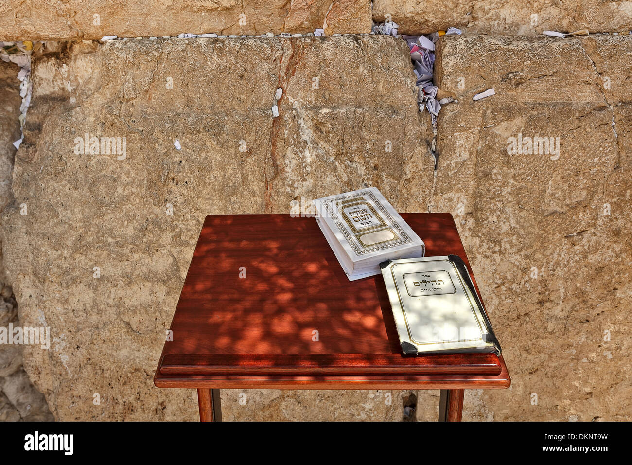 Siddur and Book of Psalms on small wooden table at Western Wall (aka Wailing Wall) in Jerusalem, Israel. - Stock Image