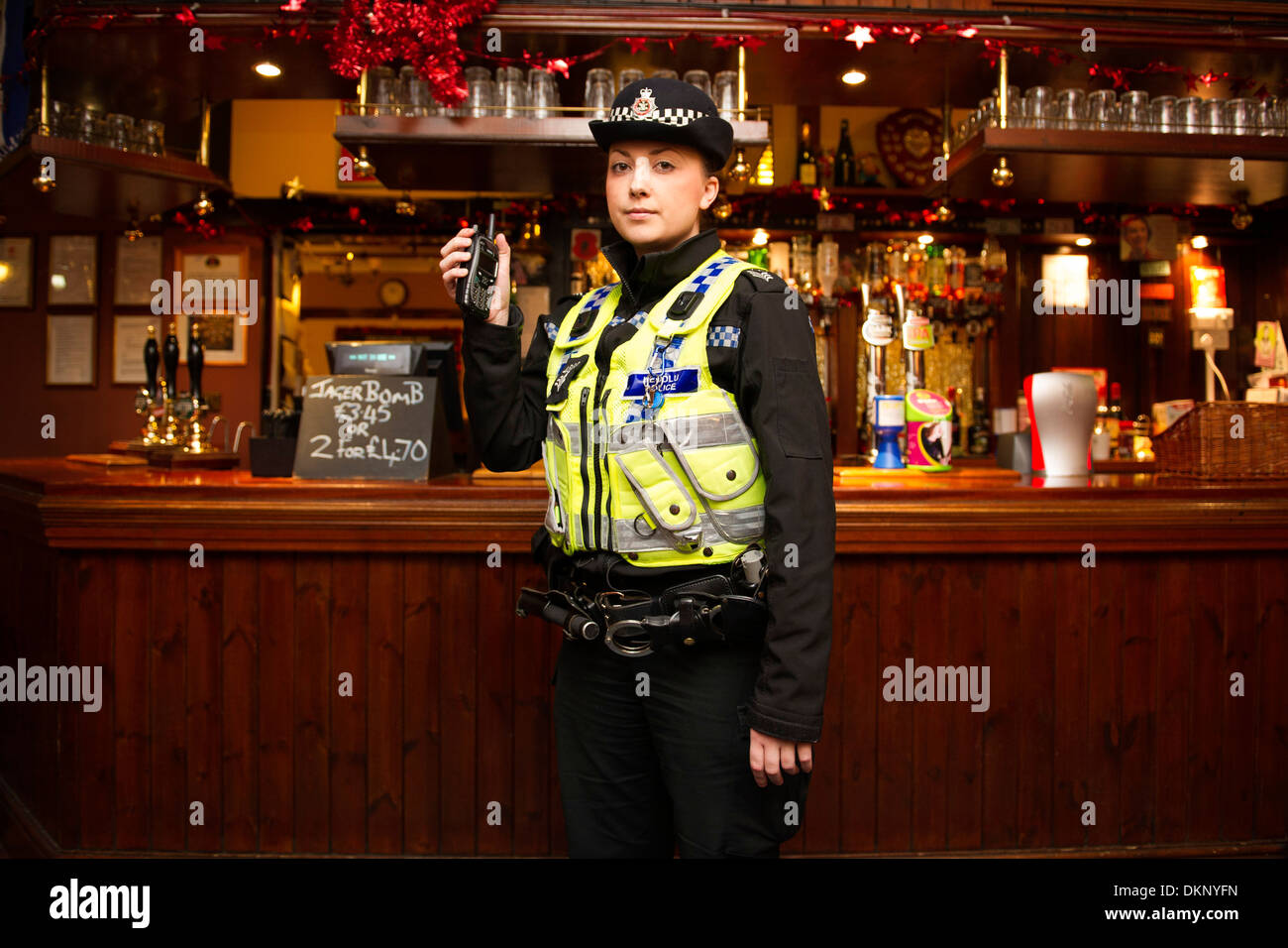 A police officer in a pub. - Stock Image