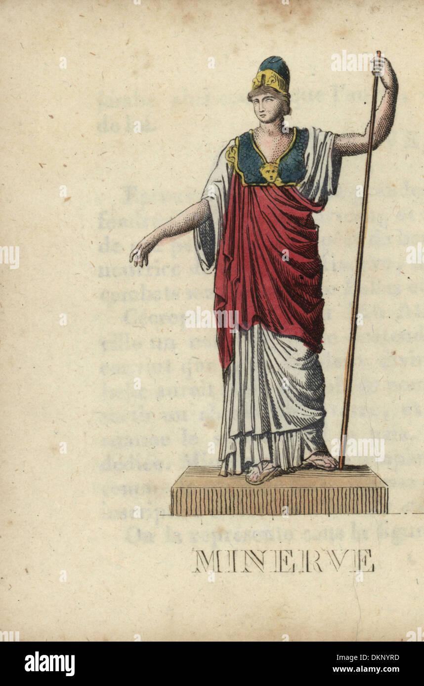 Minerva, Roman goddess of wisdom, with helmet, breastplate and staff. - Stock Image