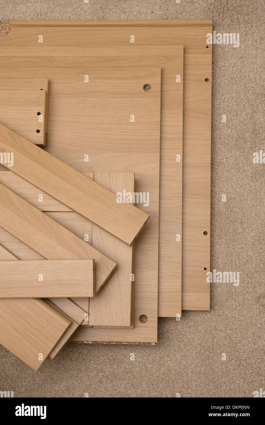 Wooden flat pack furniture ready to be assembled