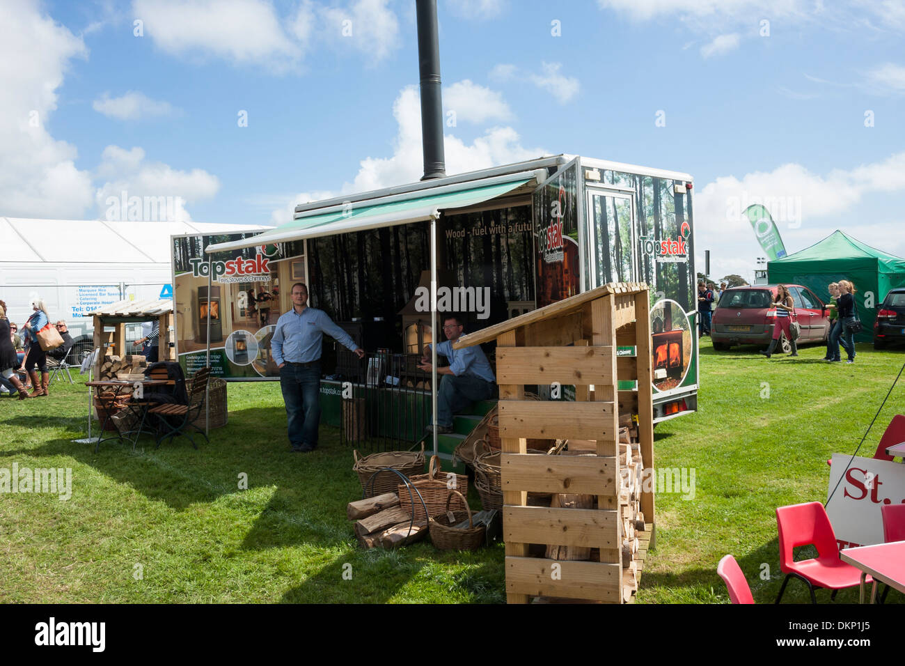 Wood fuel heating display trailer at agricultural showground - Stock Image