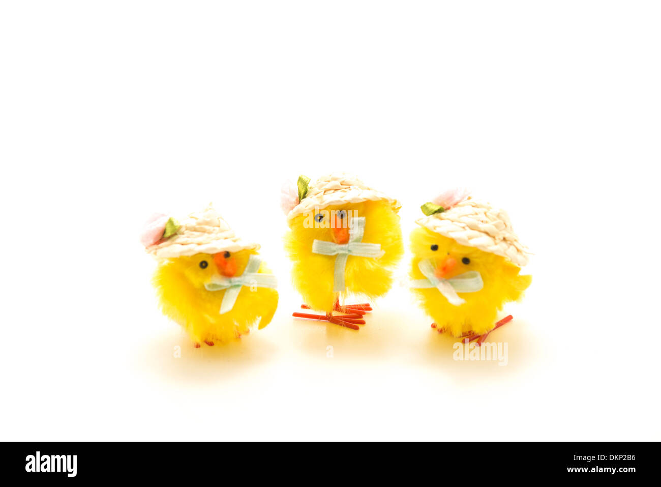 Three little Easter Chick Toys standing in a row - Stock Image