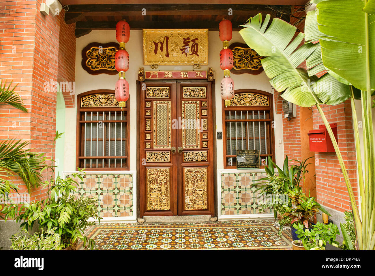 Traditional Chinese shop houses in the UNESCO World Heritage zone of Georgetown in Penang, Malaysia - Stock Image