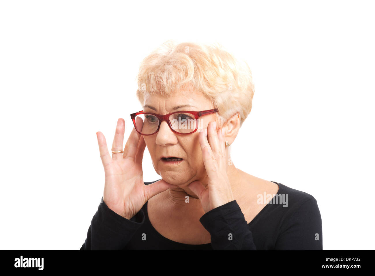 An old lady expresses shock/ surprise. Isolated on white.  - Stock Image