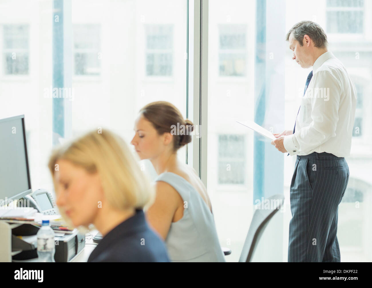 Business people working in office - Stock Image