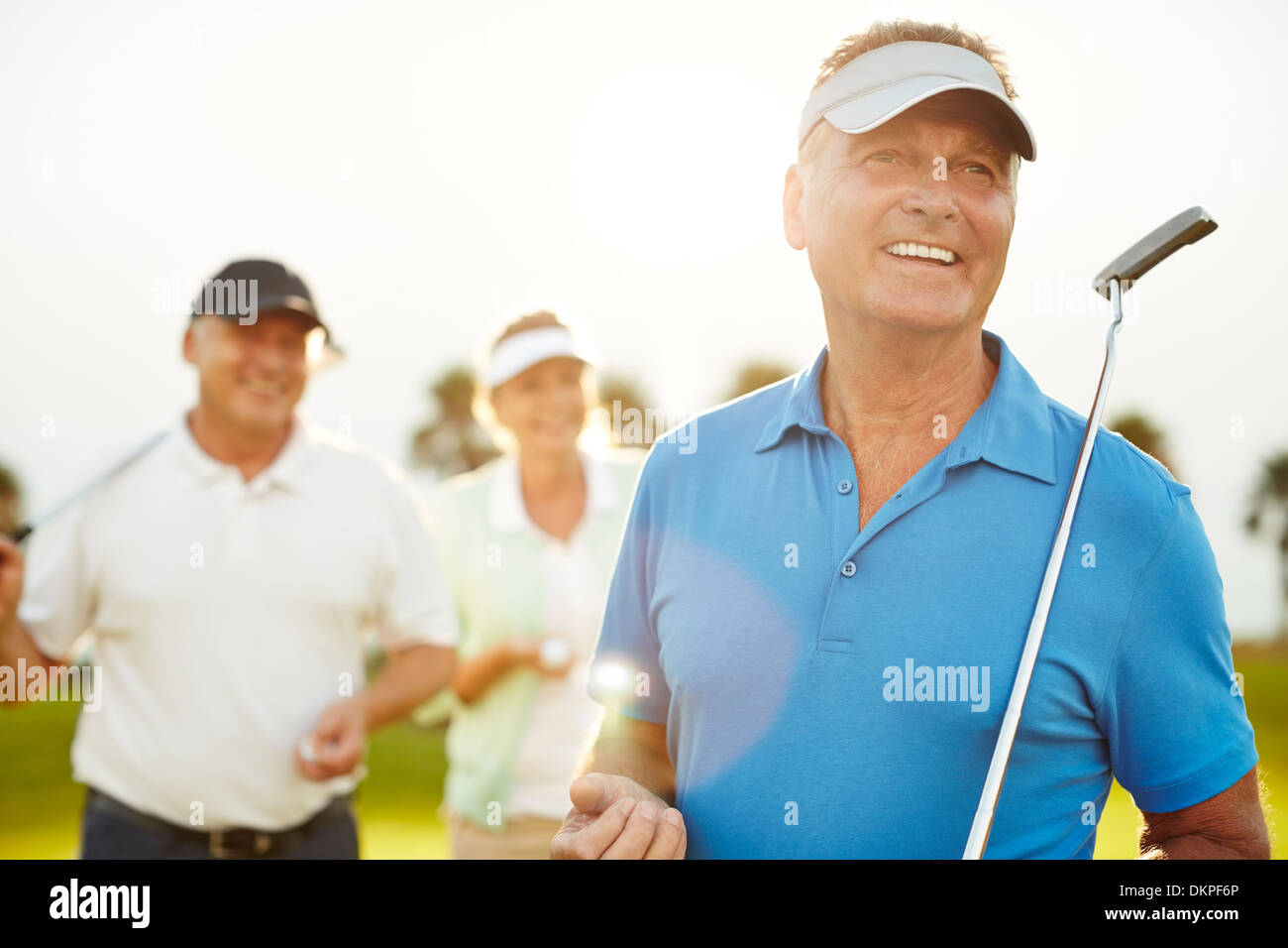 Senior adults on golf course - Stock Image