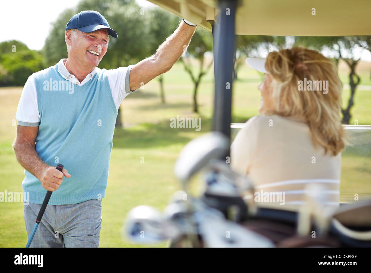Senior couple in golf cart - Stock Image