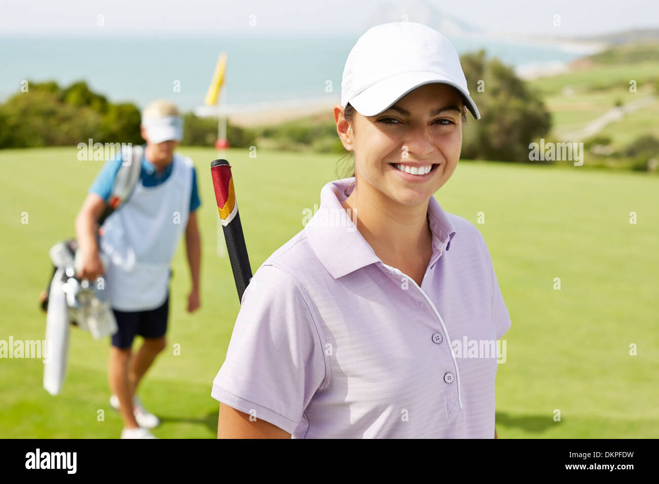Smiling woman on golf course - Stock Image