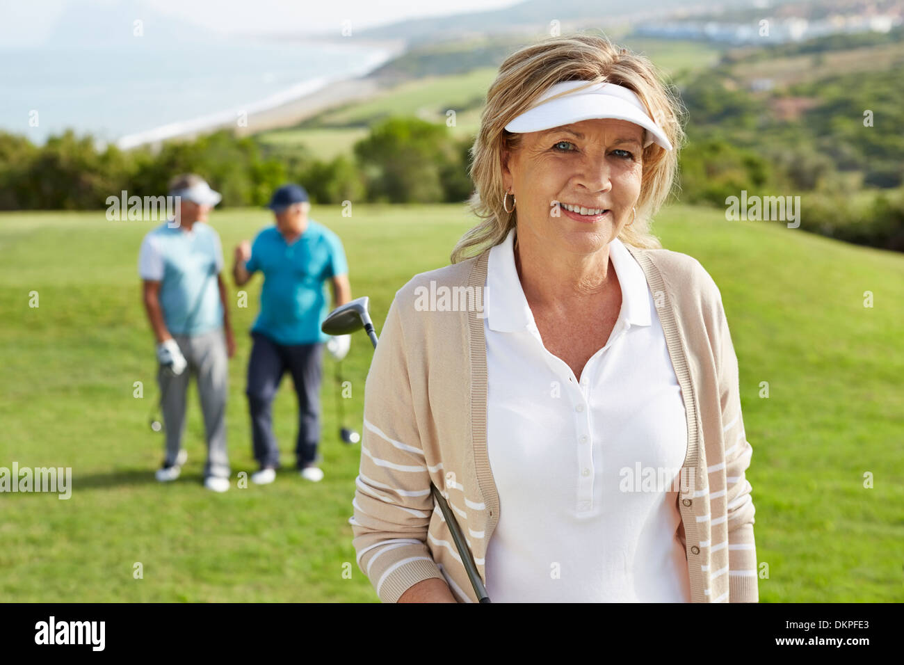 Senior friends on golf course - Stock Image