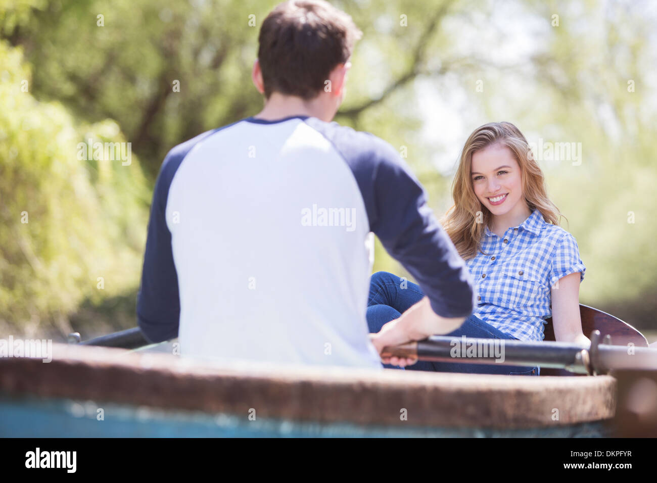 Couple in rowboat - Stock Image