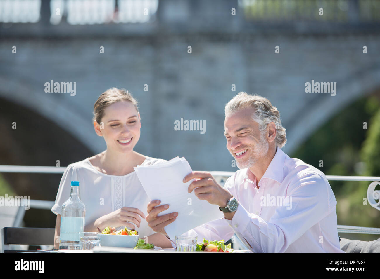 Business people talking at sidewalk cafe - Stock Image