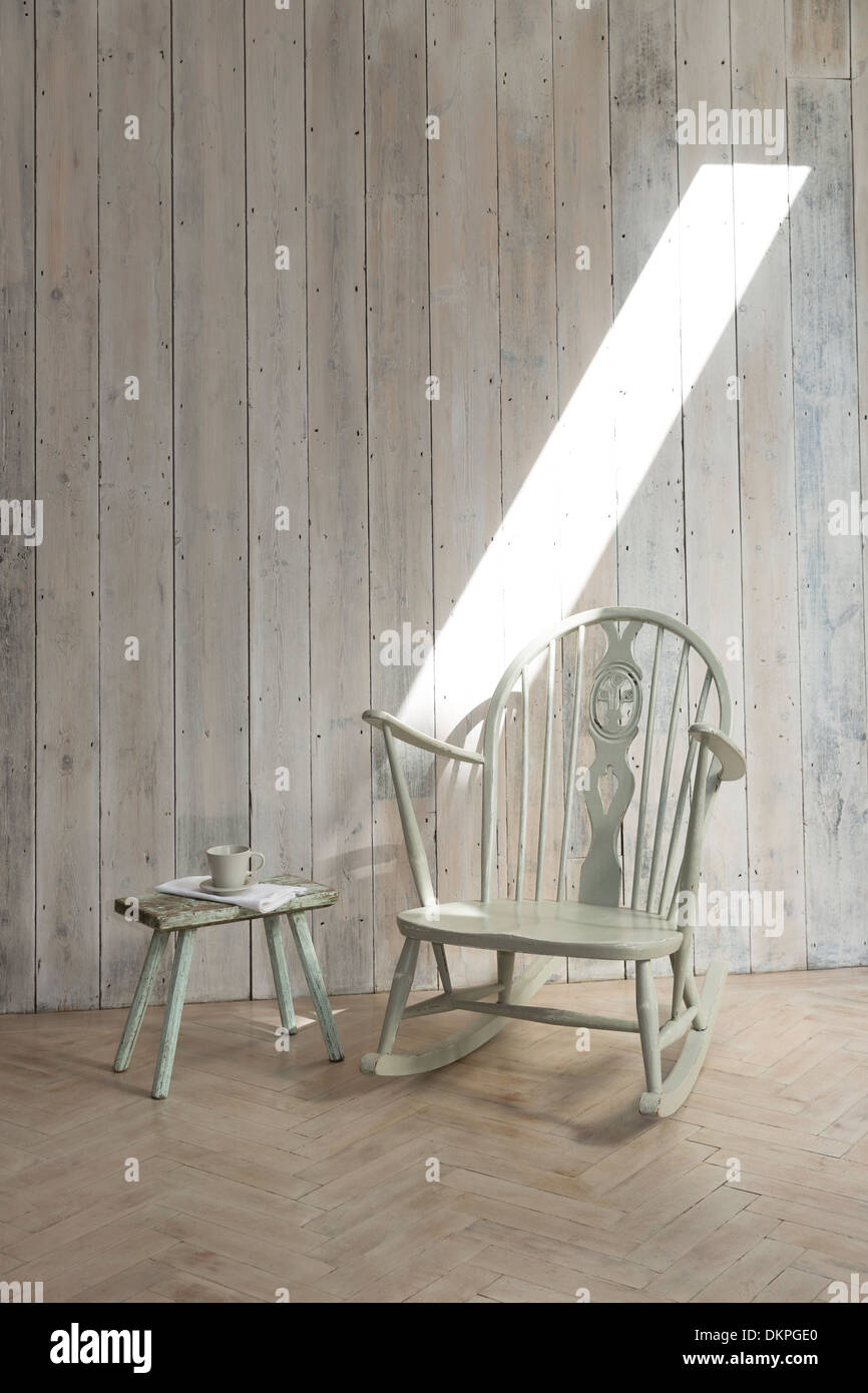 Rocking chair and side table - Stock Image