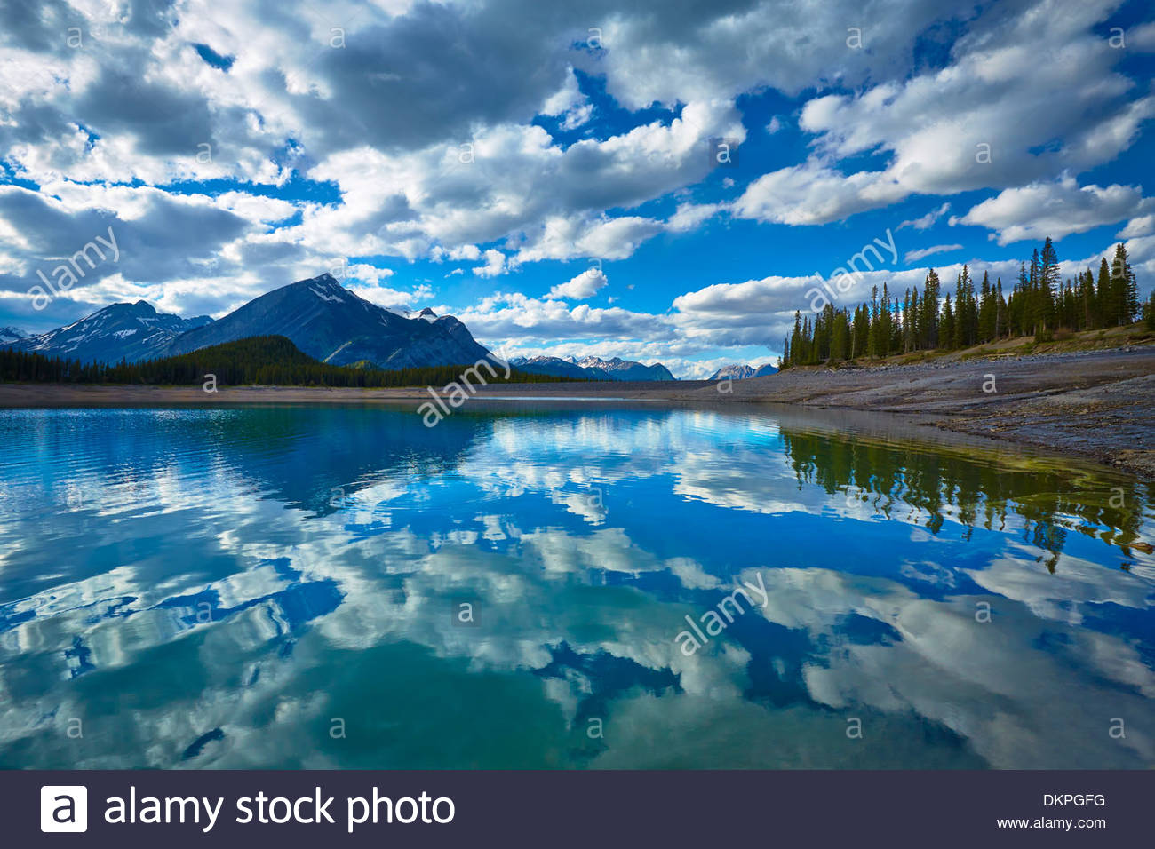 Clouds reflected in still lake - Stock Image