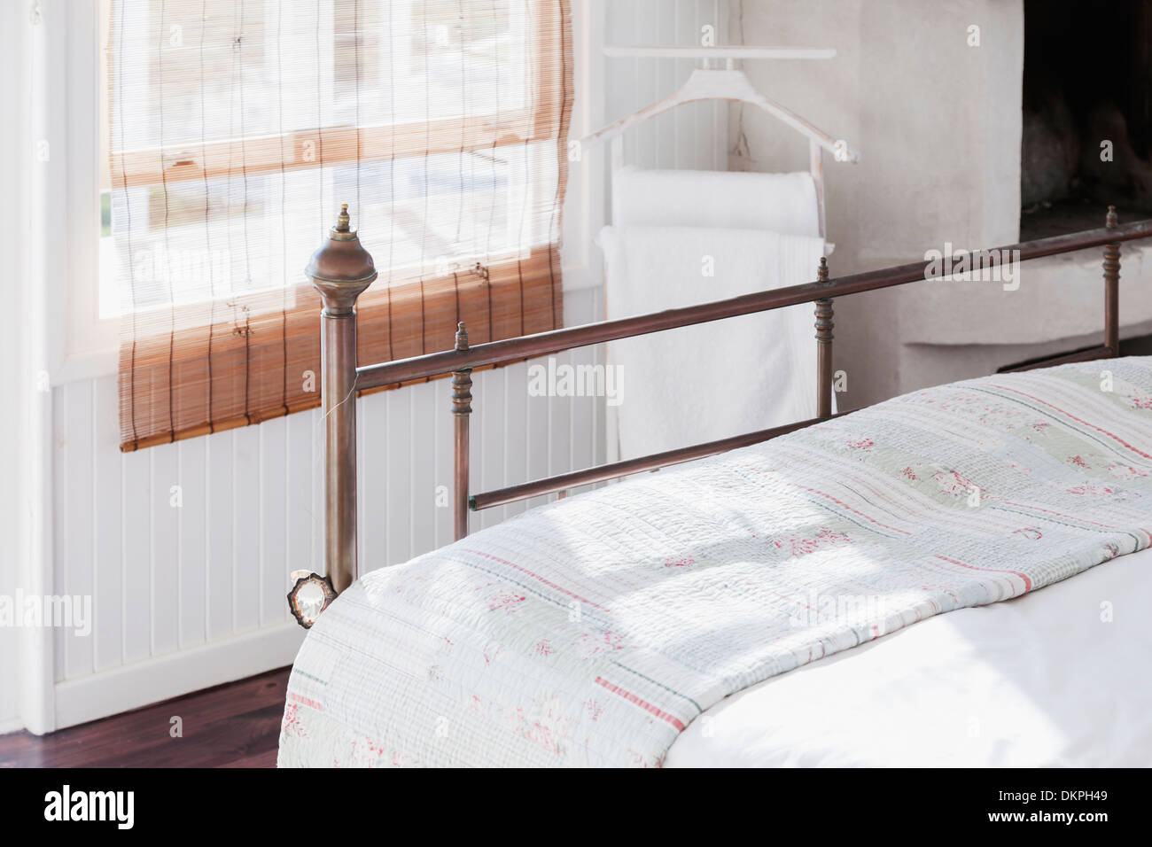 Metal frame on bed - Stock Image
